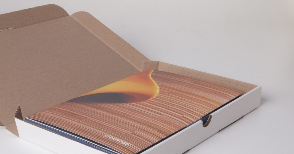 Plexwood® A blue sample box containing a hand sample in all kinds of wood and brochures