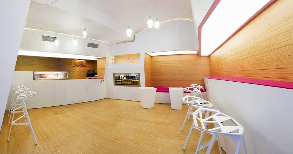 Plexwood® SoSushi back-walls, built-in seating and parquet in a modern Japanese Sushi restaurant bar in birch