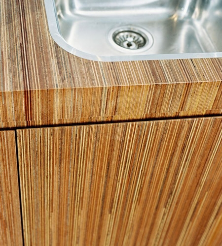 Plexwood® Consultancy Firm kitchen top with sink detail in meranti re-clamped and sliced plywood veneer
