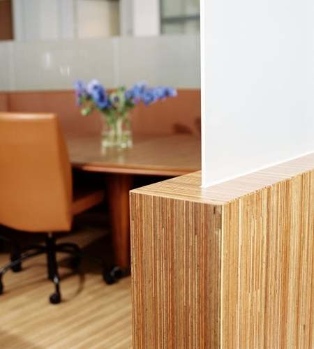 Plexwood® Consultancy Firm round wall edge detail in meranti vertical cut plywood