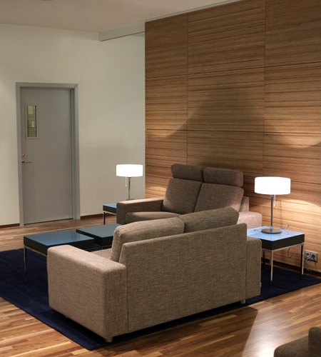 Plexwood® Iceland Air lounge wall cladding in sustainable meranti veneered wood on fire- retardant mdf