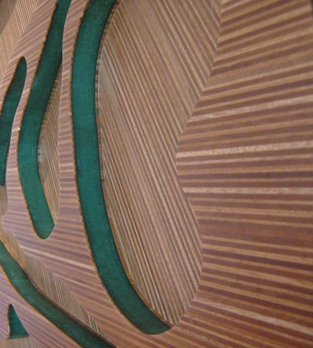 Plexwood® Annebel Noltes detail cnc processed artwork in ocoumé special veneer ply panel with green mdf