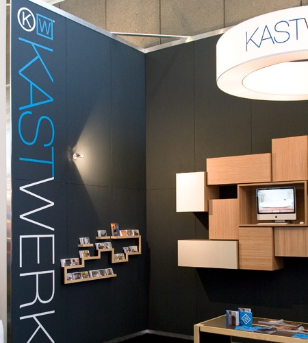 Plexwood® Kastwerk Woonbeurs wall hung cabinet in ocoumé laid-up plywood resurface veneer