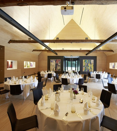 Plexwood® Kränholm Barn dining hall interior floor, wall, ceiling, cabinetry in birch quatersawn plywood veneer products