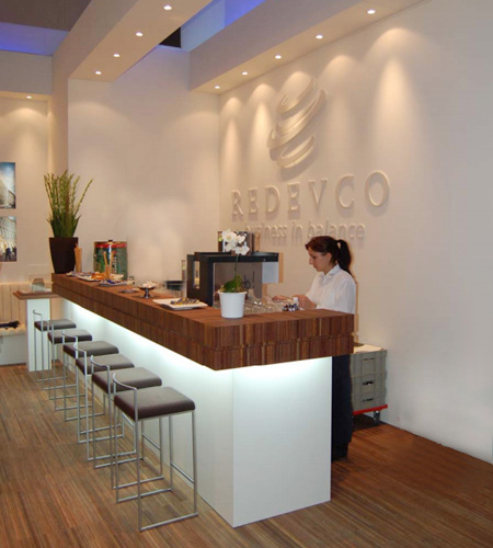 Plexwood® Redevco strip floor and bar of re-clamped standing glued layers of meranti veneer plywood
