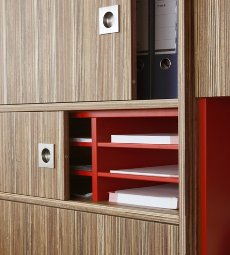 Plexwood® Rutges storage cabinet detail in comprised meranti plywood surface veneer and red HPL