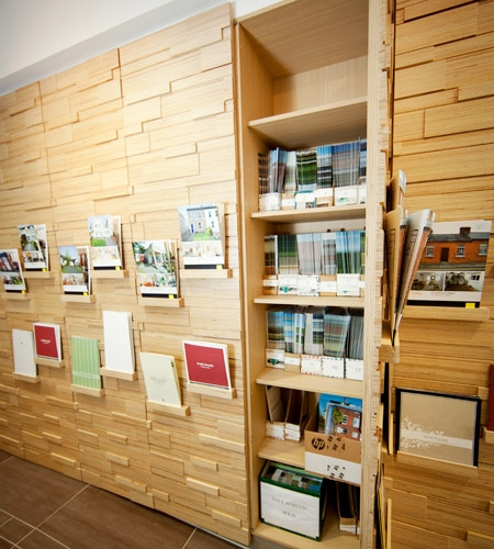 Plexwood® Savills HQ relief wall with storage cabinet in birch reverse glued plywood paneling