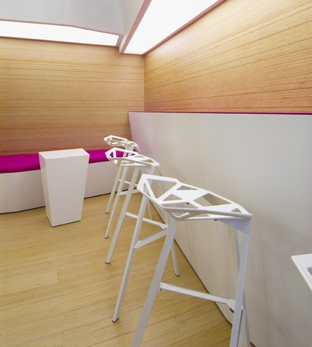 Plexwood® SoSushi modern sushi bar interior with birch floor, wall coverings and built-in seating