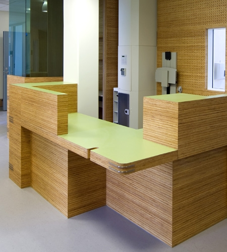Plexwood® St. Olav's reception with cnc routed acoustic perforations wall paneling in reversed glued pine plywood