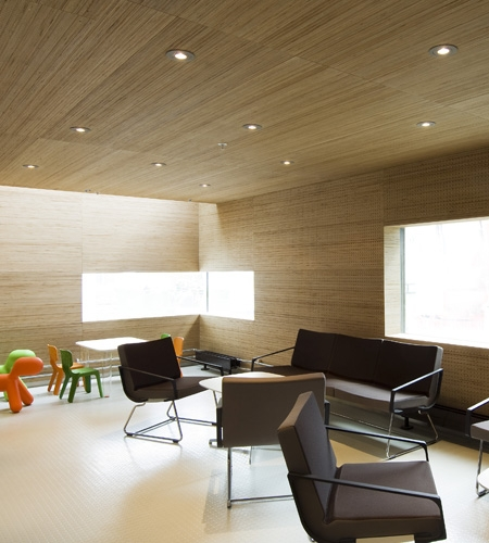 Plexwood® St. Olav's visitor's lounge overview with perforated wall, ceiling covering in birch reface plywood veneer