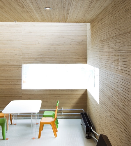 Plexwood® St. Olav's wall acoustic detail with integrated window in vertically-sliced up birch end-grain veneer ply