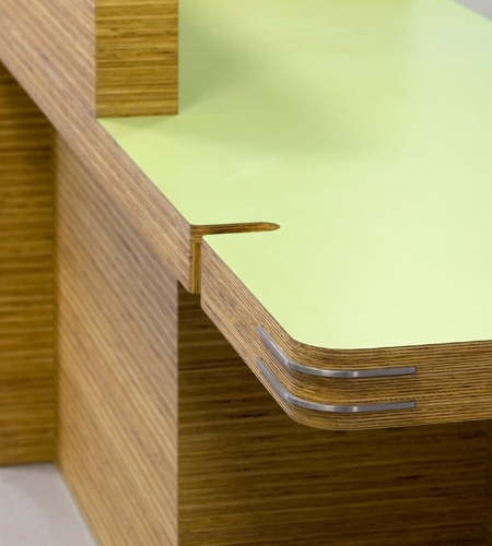 Plexwood® St. Olav's detail of a hospital desk in sandwich composite pine plywood with green HPL top