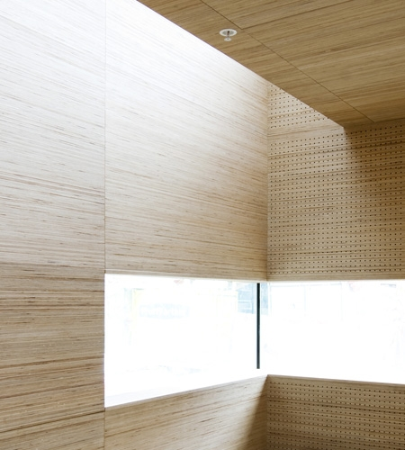 Plexwood® St. Olav's acoustic wall ceiling detail with window in reversed sandwich glued composite plywood veneer