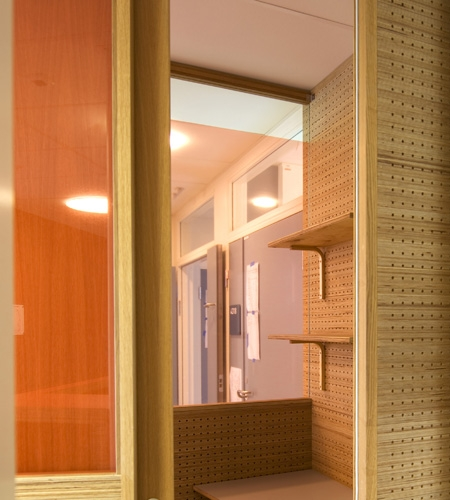 Plexwood® St. Olav's hospital telephone office cabinet detail with cnc perforated acoustic wall in pine end-glued plywood