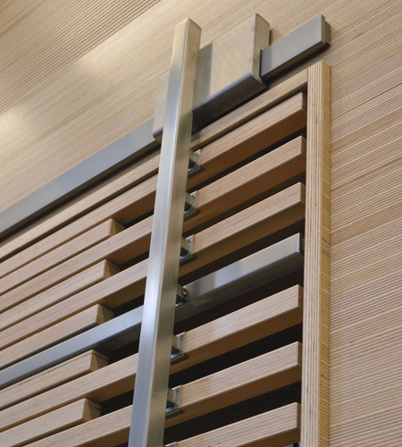 Plexwood® WBG Erfurt detail of feature wall cladding with wardrobe slider door in beech engineered edge-grain plywood
