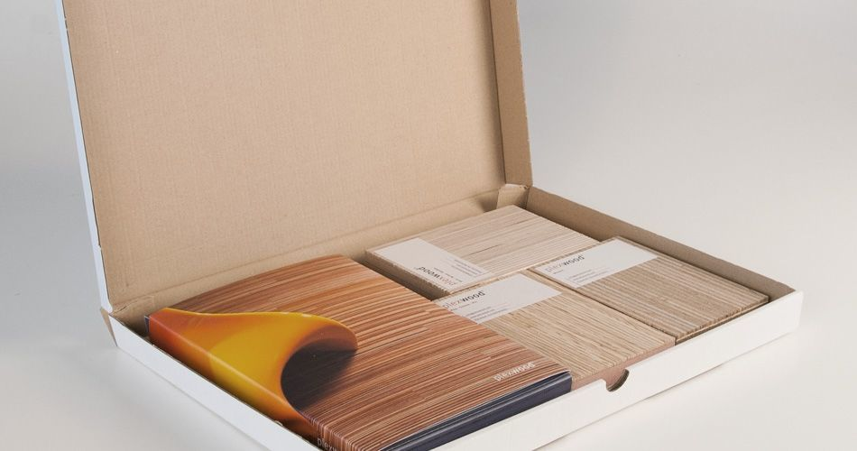 Plexwood® A blue sample box with brochures plus 3 untreated wood samples
