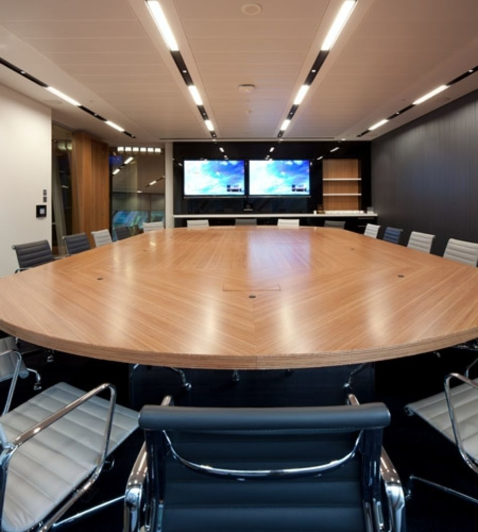 Plexwood® CBRE Global Investors large high-end conference room geometric table in ocoumé noble veneers