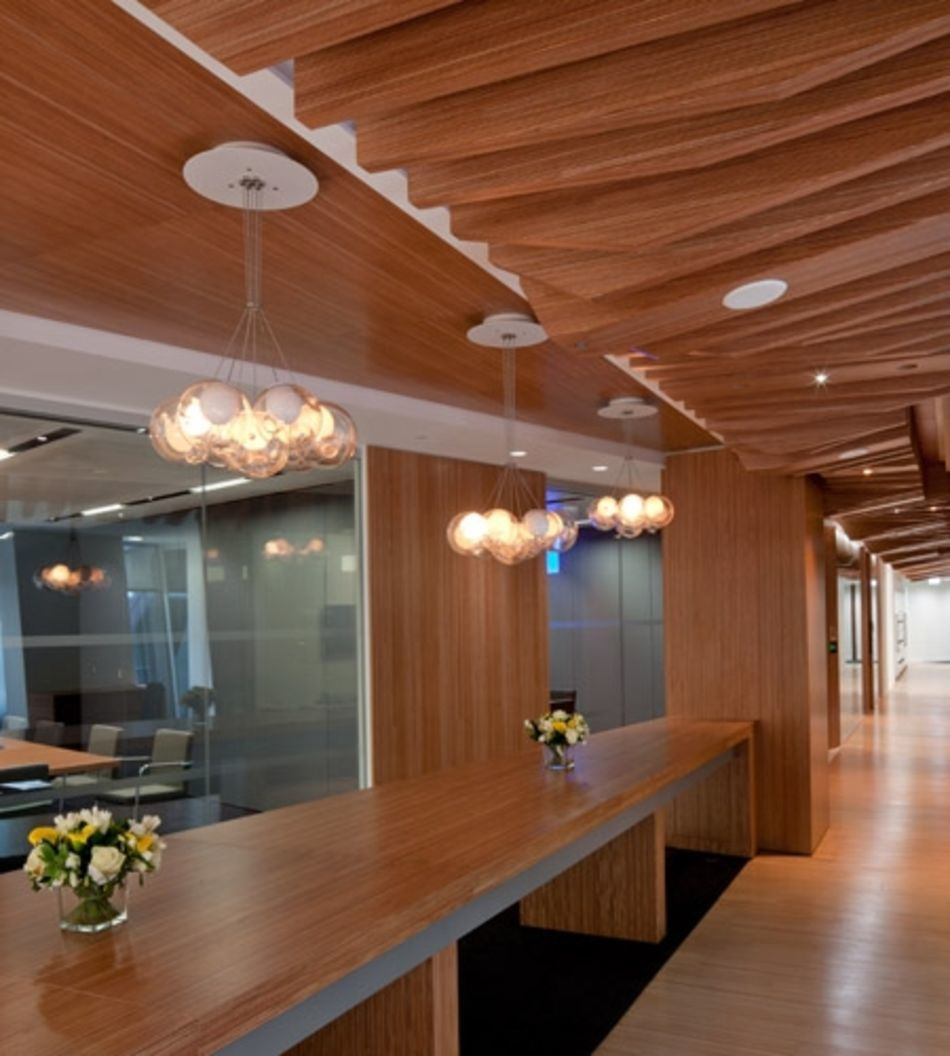 Plexwood® CBRE Global Investors office interior overview in ocoumé returned plywood with edges on its side
