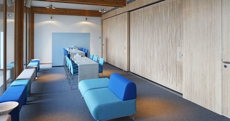 Plexwood® De Nieuwe Ooster Cemetery funeral waiting room wall covering with semi-transparent doors in birch