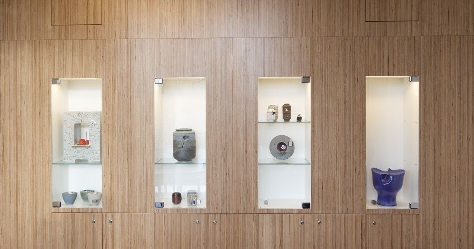 Plexwood® De Nieuwe Ooster wall display and storage cabinet of composite edge birch sandwich ply veneer
