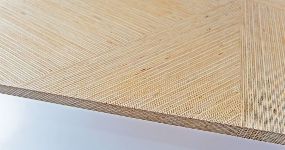 Plexwood® Deuvel design detail of a geometric patterned table with deal solid composed engineered veneer strips