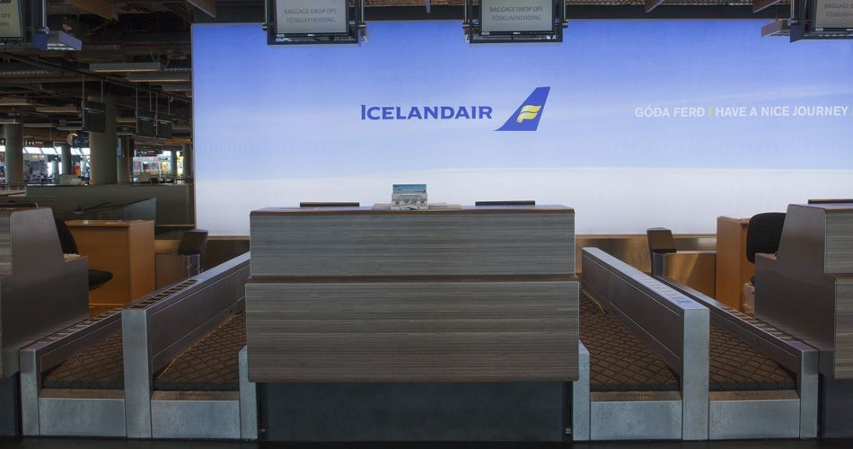 Plexwood® Iceland Air Keflavik airport check-in desk frontal in natural meranti veneer on fire- retardant safety mdf