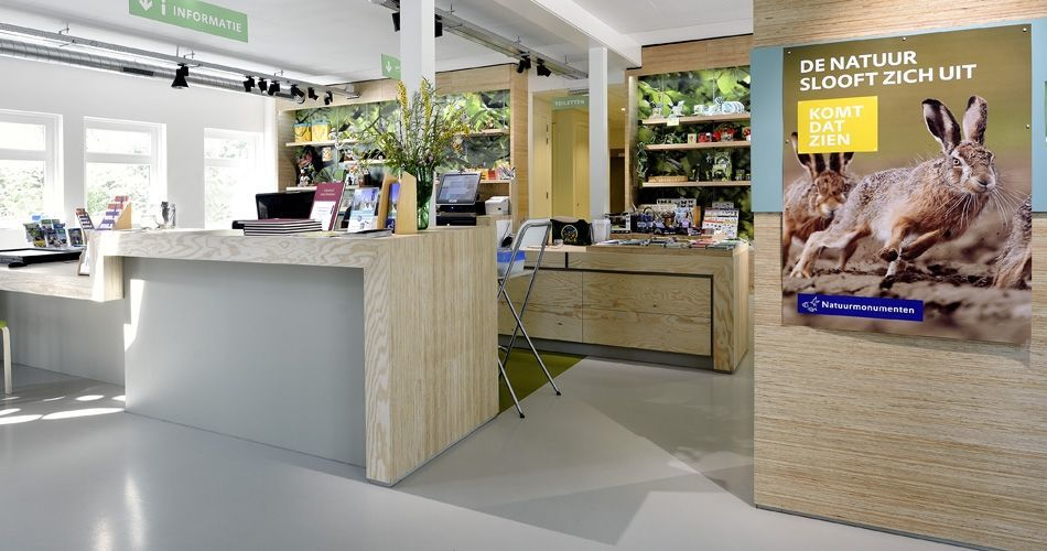 Plexwood® Nature Monuments visitor's information center desk, displays, wall and tables in vice versa pine