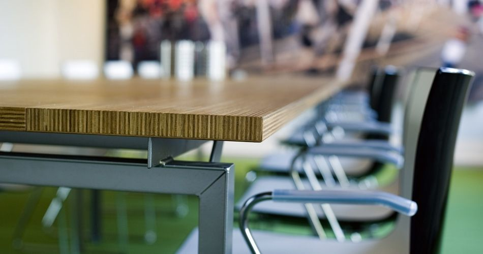 Plexwood® Nedbase conference table detail of the edges with stacked multiplex end-ply oak veneer