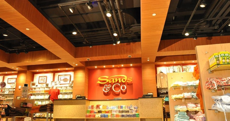 Plexwood® Sands Casino gift shop dropped ceiling detail with integrated light in ocoumé reface plywood sheets