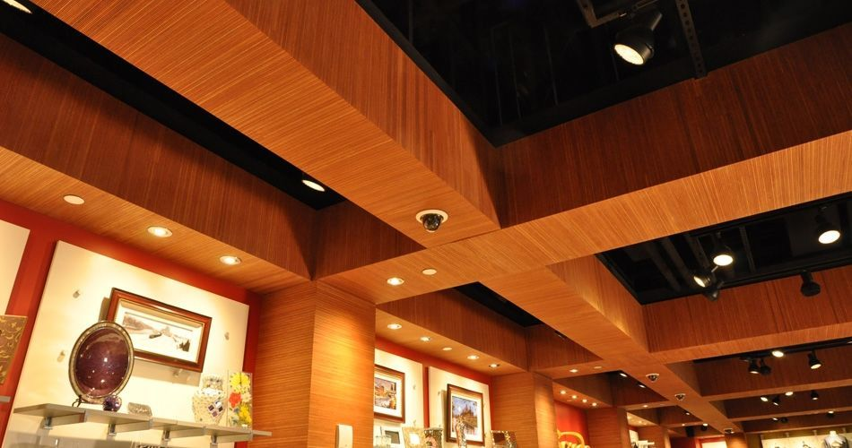 Plexwood® Sands Casino gift shop suspended ceiling detail in ocoumé quatersawn plywood veneer panels