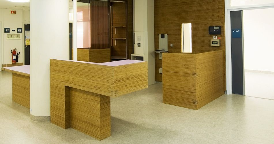 Plexwood® St. Olavs integrated open medical hospitality desk in pine re-clamped plytype safety composite veneers