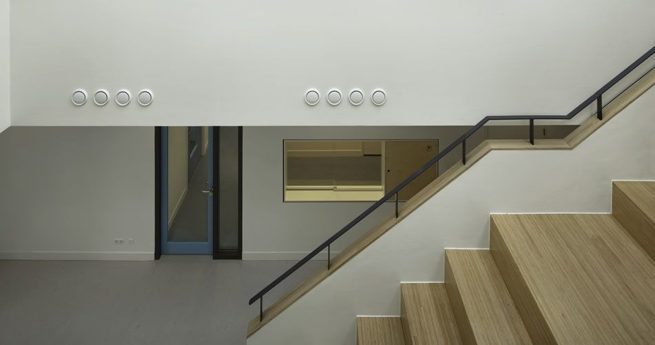 Plexwood® Van Brienenoord Public staircase detail with banister in birch re-stacked composite plywood parquet