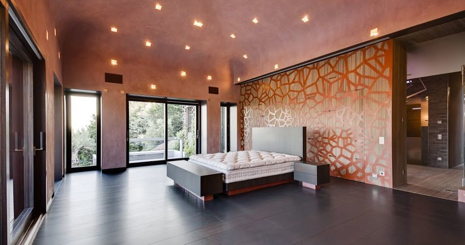 Plexwood® Bedroom back wall with integrated cabinet in design meranti veneer wood and copper panels