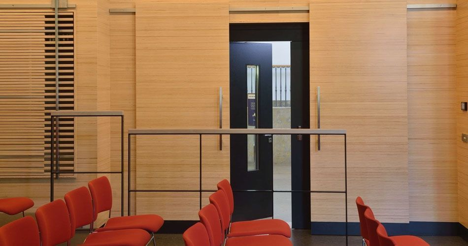 Plexwood® WBG Erfurt  presentation hall room wall cladding, slider doors and semi-transparant feature wardrobe doors