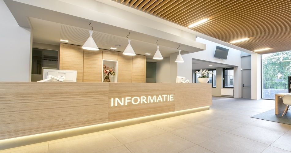 Plexwood® City hall of Montferland Didam entrance reception area and information desk with cabinets made of Plexwood Birch wood